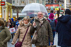 London, December 31 2017. The umbrellas come out as a downpour begins in London's west end ahead of the New Year's Eve fireworks at midnight. PICTURED: A couple share an umbrella as it begins to rain in Leicester Square . © SWNS