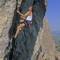 "ROCK CLIMBING. Alex Lowe (MR) leads ""Mean Streak"" near Bozeman Pass, above Bozeman, Montana."