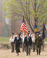 Commander of American Legion, Post 1 Doris Brady, Commander of Laconia Veterans of Foreign Wars, Post 1670 Don Doherty and Greg Schneberger former Marine and guidance councilor at MMS march towards Opechee Cove followed by Color Guard and Laconia Police officers for the Memorial Day Service Friday morning.  (Karen Bobotas/for the Laconia Daily Sun)