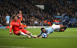Manchester City's Raheem Sterling (right) goes down in penalty area under pressure from Shakhtar Donetsk's Mykola Matviyenko (not pitctured) which results in a penalty kick