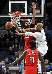 November 14, 2018 - Minneapolis, MN, USA - The Minnesota Timberwolves' Taj Gibson, right, passes the ball while being defended under the rim by the New Orleans Pelicans' Anthony Davis (23) in the second half on Wednesday, Nov. 14, 2018, at Target Center in Minneapolis. The Timberwolves won, 107-100. (Credit Image: © Aaron Lavinsky/Minneapolis Star Tribune/TNS via ZUMA Wire)