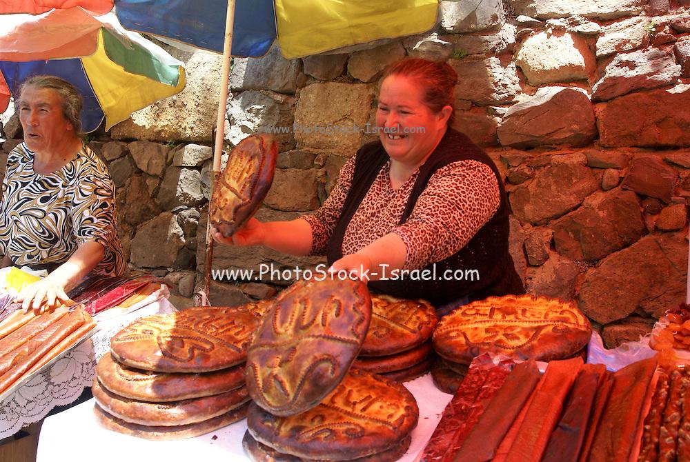 Armenia, Azat Valley, Monastery of Geghard, Women sell traditional sweet bread