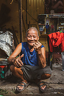 Portrait of Moon, who along with his son does bicycle tire repair in the Intramuros area of Manila, Philippines