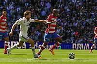 Real Madrid´s Asier Illarramendi and Granada´s Dimitri Foulquier during 2014-15 La Liga match between Real Madrid and Granada at Santiago Bernabeu stadium in Madrid, Spain. April 05, 2015. (ALTERPHOTOS/Luis Fernandez)
