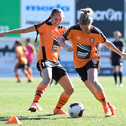 BRISBANE, AUSTRALIA - OCTOBER 30: Natalie Tathem and Abbey Lloyd of the Roar  warm up before the round 1 Westfield W-League match between the Brisbane Roar and Sydney FC at Spencer Park on November 5, 2016 in Brisbane, Australia. (Photo by Patrick Kearney/Brisbane Roar)
