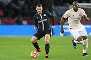 Marco Verratti of Paris Saint-Germain battles with Manchester United Forward Romelu Lukaku during the Champions League Round of 16 2nd leg match between Paris Saint-Germain and Manchester United at Parc des Princes, Paris, France on 6 March 2019.