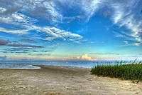 A distant thunderhead over the Gulf of Mexico at Mashes Sands in North Florida.