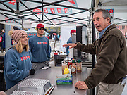 19 OCTOBER 2019 - DES MOINES, IOWA: MARK SANFORD (R-SC), right, talks to a food vender in the Des Moines Farmers' Market during a campaign visit to the market Saturday. Sanford, a former Republican governor and Congressman from South Carolina, is challenging incumbent President Donald Trump for the Republican nomination for the US presidency. Iowa hosts the first event of the presidential selection cycle. The Iowa Caucuses are scheduled for February 3, 2020.               PHOTO BY JACK KURTZ