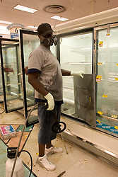 30 Sept, 2005.  New Orleans, Louisiana. Hurricane Katrina aftermath.<br /> Disaster recovery private contractors pressure wash and bleach clean the Winn Dixie supermarket in Uptown New Orleans as businesses and locals return to the city. The supermarket hopes to open on October 6th.<br /> Photo; ©Charlie Varley/varleypix.com