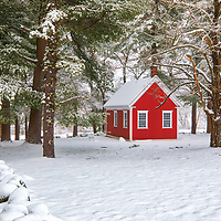 The Redstone Schoolhouse historical landmark at the historic Longfellow's Wayside Inn Historic District in Sudbury Massachusetts covered in a snowy winter wonderland.<br /> <br /> New England country photography images of the Longfellow's Wayside Inn outhouse behind the Little Red Schoolhouse are available as museum quality photo, canvas, acrylic, wood or metal prints. Wall art prints may be framed and matted to the individual liking and interior design decoration needs:<br /> <br /> https://juergen-roth.pixels.com/featured/the-redstone-schoolhouse-juergen-roth.html<br /> <br /> Good light and happy photo making!<br /> <br /> My best,<br /> <br /> Juergen