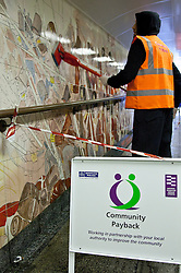© under license to London News Pictures. 05/04/11. Ahead of the Royal Wedding in April, an offender cleans the underpass at Hyde Park Corner tube station of graffiti and grime. Offenders were taking part in a Community Payback scheme managed by the London Probation Trust in anticipation of thousands of people using subways to get around London during the wedding weekend. Credit should read Matt Cetti-Roberts/LNP