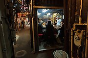 A bar in Omoide Yokocho,  (Welcome Alley) though more commonly called Piss Alley. Shinjuku, Tokyo, Japan Friday November 27th 2015 This area of small, rough standing bars hides down the side of Shinjuku station and is a remnant of the post-war development when business sprung up on any spare land. Often threatened with demolition and redevelopment the area is enjoying something of a renaissance and has been cleaned up and made less of a fire risk recently .