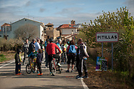 """People waits to receive the 20th Korrika. Pitillas (Basque Country). April 1, 2017. The """"Korrika"""" is a relay course, with a wooden baton that passes from hand to hand without interruption, organised every two years in a bid to promote the basque language. The Korrika runs over 11 days and 10 nights, crossing many Basque villages and cities. This year was the 20th edition and run more than 2500 Kilometres. Some people consider it an honour to carry the baton with the symbol of the Basques, """"buying"""" kilometres to support Basque language teaching. (Gari Garaialde / Bostok Photo)"""
