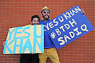 """two AFC Wimbledon fans with a banner saying """"Yes u Khan"""" in support of newly elected London Mayor Sadiq Khan outside The Cherry Red Records Stadium before k/o. Skybet football league two play off semi final, 1st leg match, AFC Wimbledon v Accrington Stanley at the Cherry Red Records Stadium in Kingston upon Thames, Surrey on Saturday 14th May 2016.<br /> pic by John Patrick Fletcher, Andrew Orchard sports photography."""