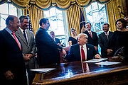 President Donald Trump shakes hands with Leo W. Gerard, president of the United Steelworkers, after signing a memorandum ordering the investigation of whether foreign steel imports are harming US national security in the Oval Office of the White House in Washington, District of Columbia, U.S., on Thursday, April 20, 2017.  The order directs Commerce Secretary Wilbur Ross to conduct the within 270 days, before Trump decides on curbing the import of foreign steel.