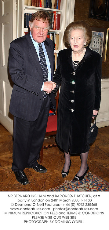SIR BERNARD INGHAM and BARONESS THATCHER, at a party in London on 24th March 2003.PIH 33
