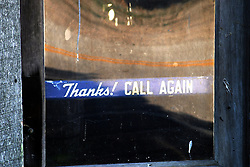 09 June 2012:   Thanks, Call Again window sign is displayed in the door of the Funks Grove Country Store.