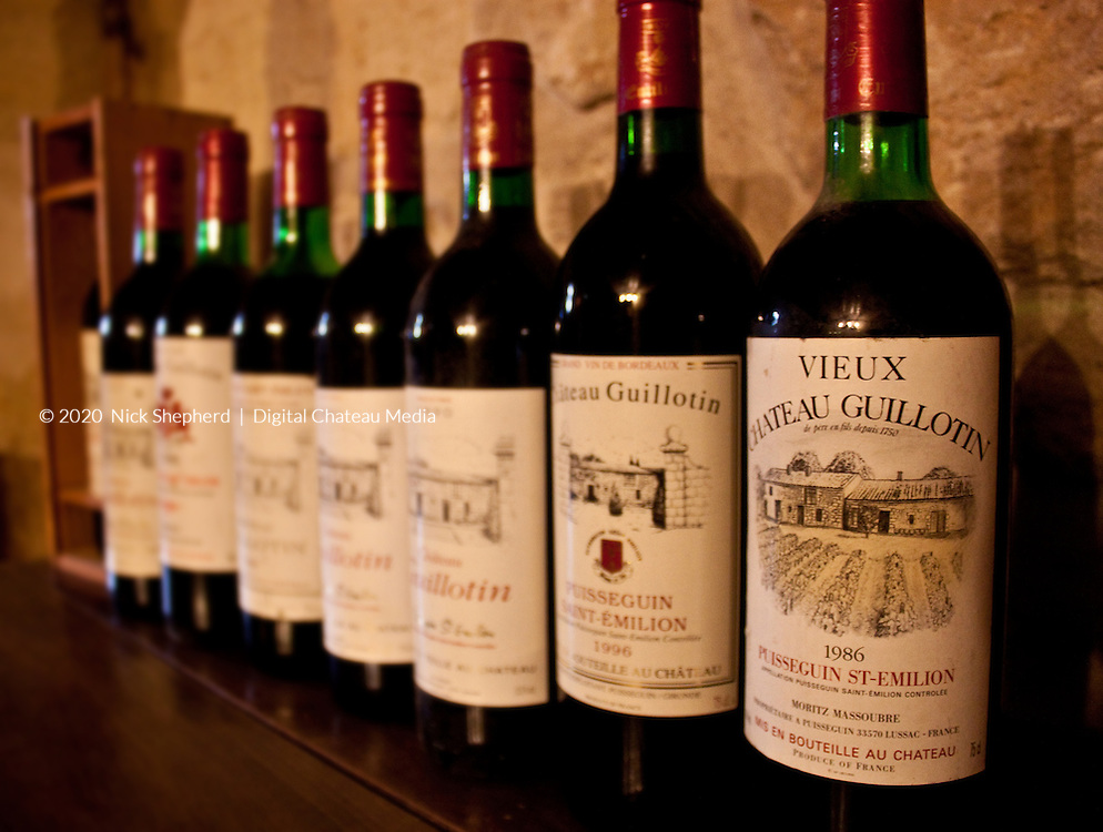 Wines of Chateau Guillotin, Puisseguin St Emilion, showing some of the older labels.