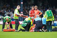Paramedics assist Luton Town midfielder Eunan O'Kane (32) during the EFL Sky Bet League 1 match between Luton Town and Bristol Rovers at Kenilworth Road, Luton, England on 15 September 2018.