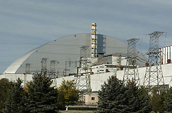 October 5, 2018 - Kiev, Kiev, Ukraine - The protective shelter over the remains of 4th nuclear block of Chernobyl Nuclear Power Plant is seen at the Chernobyl..Solar Chernobyl power plant has about 16,000 square meters of 3,800 solar panels expected to generate 1.0 MWp of electricity each year, this is a joint project of Rodina – Enerparc AG Consortium founded in 2013 and its objectives is to implement renewable energy projects in the areas that were demolished by the Chernobyl catastrophe, its production capacity of Solar Chernobyl is 1024 MWh/year. (Credit Image: © Pavlo Gonchar/SOPA Images via ZUMA Wire)