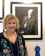 "Manhasset, New York, U.S., September 8, 2019. Ann Parry poses next to her photo ""Buzz Aldrin"" - the 1st Place winner of The Art Guild's ""About Face: The Portrait"" juried competition, at Elderfields. photo courtesy Bob Stuhmer"