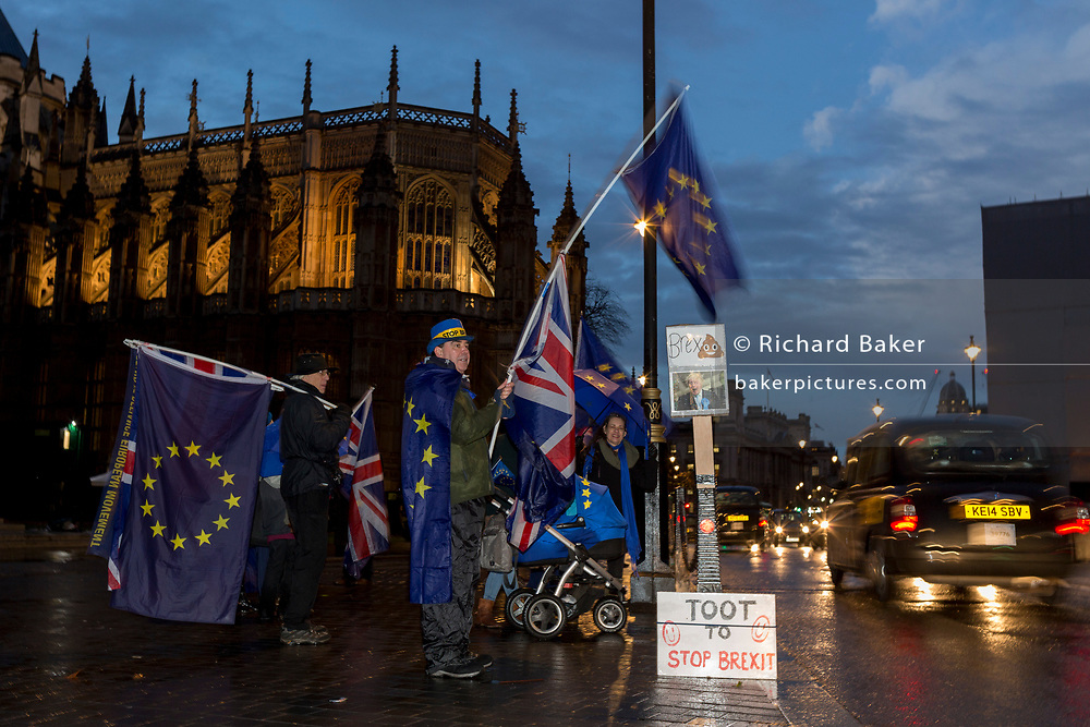 While MPs debate the Brexit Withdrawal Bill and ultimately vote in the House of Commons, Pro-EU Anti-Brexit protesters wave EU and Union Jack flags next to a parody of leading Brexiteer Boris Johnson outside Parliament, on 13th December 2017 in London, England.