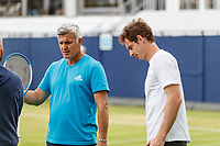 Tennis - 2019 Queen's Club Fever-Tree Championships - Day Three, Wednesday<br /> <br /> Men's Singles, First Round: Juan Martin Del Potro (ARG) Vs. Denis Shapovalov (CAN)<br /> <br /> Apostolos Tsitsipas (GRE) Coach/Father of no. 1 seed talks with Andy Murray (GBR) ahead of his arm up on the practice court.<br />  <br /> COLORSPORT/DANIEL BEARHAM