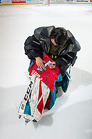 KELOWNA, CANADA - MARCH 16: James Porter #1 of the Kelowna Rockets autographs his spiderman jersey on March 16, 2019 at Prospera Place in Kelowna, British Columbia, Canada.  (Photo by Marissa Baecker/Shoot the Breeze)