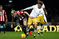 Sergi Canos of Brentford (L) battles with Liam Palmer of Sheffield Wednesday (R). EFL Skybet football league championship match, Brentford v Sheffield Wednesday at Griffin Park in London on Saturday 30th December 2017.<br /> pic by Steffan Bowen, Andrew Orchard sports photography.