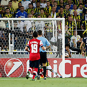 Fenerbahce's Gokhan Gonul (L) during the UEFA Champions League Play-Offs First leg soccer match Fenerbahce between Arsenal at Sukru Saracaoglu stadium in Istanbul Turkey on Wednesday 21 August 2013. Photo by Aykut AKICI/TURKPIX