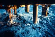 Alaska. Cook Inlet. Tidal action under an oil platform.