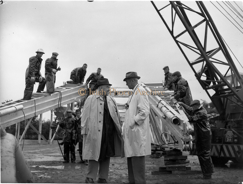 03/08/1962<br /> 08/03/1962<br /> 03 August 1962<br /> Oil representatives at Rathmolyon, Co. Meath. Mr F. Kirk Johnston, Chairman, Ambassador Oil Corporation, and President Ambassador Irish Oil Co. and Mr James Stewart, Film Star and Ambassador Shareholder pictured chatting  on the site of the 1st Oil Drilling at Rathmoylon, as workers assemble the rig.