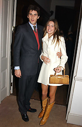 MISS AMANDA SHEPPARD and MR RICHARD O'HAGAN at a party to celebrate the 4th anniversary of Quintessentially held at 11 Grosvenor Place, London  SW1 on 14th December 2004.<br /><br />NON EXCLUSIVE - WORLD RIGHTS