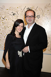 ROBIN DERRICK and his wife LISA ELDRIDGE at an exhibition entitled 'Cut Flowers' by Robin Derrick held at 70a Silverthorne Road, London SW8 on 8th October 2008.
