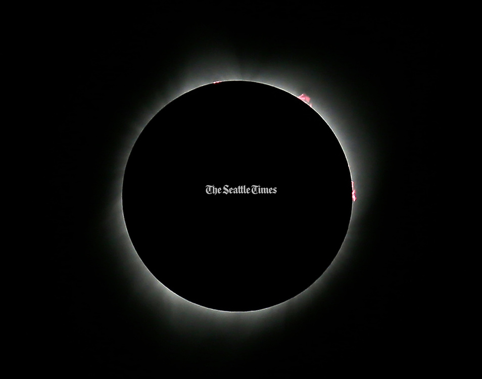 The eclipse reached totality at 10:19:34 a.m. [August 21, 2017] in Madras, Ore. Seattle Times photographer Greg Gilbert snapped this photo using a 300mm lens with a 1.4 extender and a 10X neutral density filter. (Greg Gilbert / The Seattle Times)