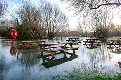 © Licensed to London News Pictures. 22/12/2019. Aylesbury, UK. Tables at the Old Fisherman pub in Shabbington sit in water after the River Thame burst its banks during heavy rain across Buckinghamshire. Photo credit: Peter Manning/LNP