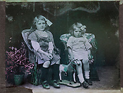 Colourised magic lantern slide family portrait of two young girls presumably sisters circa 1900