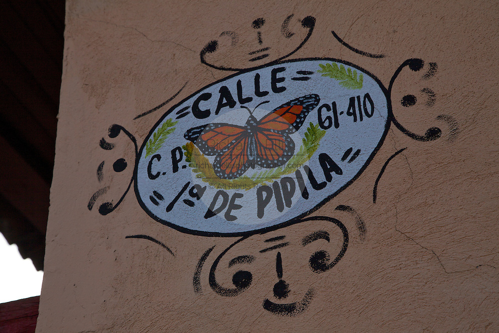 A street sign in Angangueo, Mexico in the center of the Monarch Butterfly Biosphere Reserves in central Mexico in Michoacan State. The town celebrates the Monarch Butterflies which attract tourists from around the world. Each year hundreds of millions Monarch butterflies mass migrate from the U.S. and Canada to Oyamel fir forests in the volcanic highlands of central Mexico. North American monarchs are the only butterflies that make such a massive journey—up to 3,000 miles (4,828 kilometers).