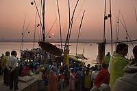 Pilgrims at sunrise on the ghats during the festival of Kartik Poornima in Varanasi, Uttar Pradesh, India