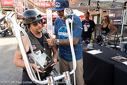 MC Jason Hallman of Torque Magazine and Curtis Watson, winner of the Daily Rider class in the Dennis Kirk Garage Build bike show, on his 1989 FXSTS at the Iron Horse Saloon during the Sturgis Motorcycle Rally. SD, USA. Tuesday, August 10, 2021. Photography ©2021 Michael Lichter.