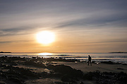 © Licensed to London News Pictures. 15/02/2016. Anglesey, UK Sunset over Rhosneigr Beach in Anglesey today 15th February 2016. Photo credit : Stephen Simpson/LNP