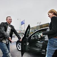 Nederland, Amsterdam , 28 oktober 2011..Autorij-instructeur Guildo Baas..Car driving instructor Guildo Baas teaching a pupil in a tuition car: how to drive a car.