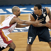 Galatasaray's Preston SHUMPERT (L) and Efes Pilsen's Lawrence ROBERTS (R) during their BEKO Basketball League derby match Galatasaray between Efes Pilsen at the Abdi Ipekci Arena in Istanbul at Turkey on Sunday, March 06 2011. Photo by TURKPIX