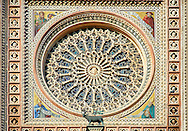 Detail of the rose window built by the sculptor and architect Orcagna between 1354 and 1380 on the14th century Tuscan Gothic style facade of the Cathedral of Orvieto, designed by Maitani, Umbria, Italy .<br /> <br /> Visit our ITALY HISTORIC PLACES PHOTO COLLECTION for more   photos of Italy to download or buy as prints https://funkystock.photoshelter.com/gallery-collection/2b-Pictures-Images-of-Italy-Photos-of-Italian-Historic-Landmark-Sites/C0000qxA2zGFjd_k<br /> .<br /> <br /> Visit our MEDIEVAL PHOTO COLLECTIONS for more   photos  to download or buy as prints https://funkystock.photoshelter.com/gallery-collection/Medieval-Middle-Ages-Historic-Places-Arcaeological-Sites-Pictures-Images-of/C0000B5ZA54_WD0s