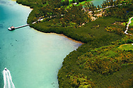Mauritius Island. Tourquoise water from air. A boat