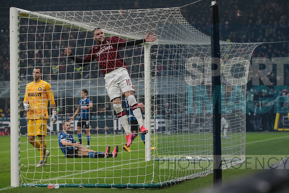 Ante Rebic of AC Milan leaps into the back of the net in despair after going close to scoring his second goal during the Serie A match at Giuseppe Meazza, Milan. Picture date: 9th February 2020. Picture credit should read: Jonathan Moscrop/Sportimage