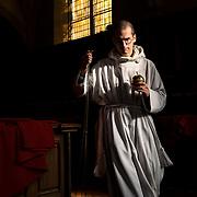 A young monk brings the encense burner back to the sacristy after the celebration of Mass. Solesmes on 18-10-19<br /> Un jeune moine rapporte l'encensoir à la sacristie après la célébration de la messe. Solesmes le 18-10-19