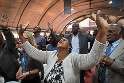 27 October 2019, Addis Ababa, Ethiopia: A woman raises her arms in prayer during Sunday service at the Finfinne Oromo Mekane Yesus Congregation of the Ethiopian Evangelical Church Mekane Yesus. In a context where congregations did not use to be allowed to hold their services in any language but Amharic, the congregation today is one of some 60 Oromo speaking Mekane Yesus congregations in Addis Ababa. The service takes place on the first Sunday following political turmoil in the country, claiming dozens of lives.