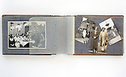 open family photo album with cut and assembled images from 1920s England