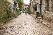 Israel, upper Galilee, Rosh Pinna a female tourist in the renovated old town centre. Rosh Pina founded in 1882 by thirty immigrant families from Romania, making it one of the oldest Zionist settlements in Israel